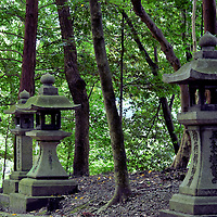Stone Lanterns at Fushimi Inari Taisha in Kyoto, Japan<br />