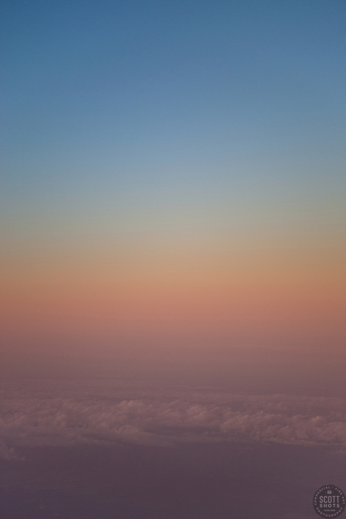 """Sunset Above the Clouds 3"" - This sunset was photographed from an airplane above the clouds."