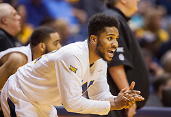 Jan 26, 2016; Morgantown, WV, USA; West Virginia Mountaineers guard Tarik Phillip (12) celebrates from the bench during the first half against the Kansas State Wildcats at the WVU Coliseum. Mandatory Credit: Ben Queen-USA TODAY Sports