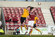Newport County Defender Ben Davies battles with Northampton Town Striker John Marquis during the Sky Bet League 2 match between Northampton Town and Newport County at Sixfields Stadium, Northampton, England on 25 March 2016. Photo by Dennis Goodwin.