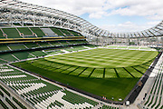 Low angle view of Aviva Stadium, 2010, by Populous/Scott Tallon Walker, Dublin Ireland, in the afternoon. Built on the site of the old Lansdowne Road Rugby Stadium which was demolished in 2007, the new venue hosts Football and Rugby matches, and concerts. The 55,000 seat four tiered structure, with its asymmetric stadium bowl is wrapped in translucent polycarbonate shingles which form both walls and roof. Picture by Manuel Cohen