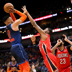 Feb 14, 2019; New Orleans, LA, USA; Oklahoma City Thunder guard Russell Westbrook (0) shoots overNew Orleans Pelicans guard E'Twaun Moore (55) during the second quarter at the Smoothie King Center. Mandatory Credit: Derick E. Hingle-USA TODAY Sports