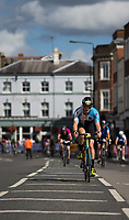 Competitors pass through Wimbledon Village during the Prudential RideLondon-Surrey 100. Prudential RideLondon 30/07/2017<br /> <br /> Photo: Adam Warner/Silverhub for Prudential RideLondon<br /> <br /> Prudential RideLondon is the world's greatest festival of cycling, involving 100,000+ cyclists – from Olympic champions to a free family fun ride - riding in events over closed roads in London and Surrey over the weekend of 28th to 30th July 2017. <br /> <br /> See www.PrudentialRideLondon.co.uk for more.<br /> <br /> For further information: media@londonmarathonevents.co.uk