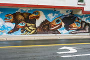 Tlingit artwork on Juneau City Hall. The City and Borough of Juneau is the capital city of Alaska and the second largest city in the USA by area (only Sitka is larger). This unified municipality lies on Gastineau Channel in the Alaskan panhandle. Juneau has been the capital of Alaska since 1906, when the government of what was the District of Alaska was moved from Sitka. The city is named after a gold prospector from Quebec, Joe Juneau. Isolated by rugged terrain on Alaska's mainland, Juneau can only be reached by plane or boat. Downtown Juneau sits at sea level under steep mountains up to 4000 feet high, topped by Juneau Icefield and 30 glaciers.