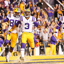 November 17, 2012; Baton Rouge, LA, USA;  LSU Tigers wide receiver Odell Beckham (3) celebrates with teammates wide receiver Jarvis Landry (80) and safety Micah Eugene (34) after returning a punt for a touchdown during the fourth quarter of a game against the Ole Miss Rebels at Tiger Stadium. LSU defeated Ole Miss 41-35. Mandatory Credit: Derick E. Hingle-US PRESSWIRE