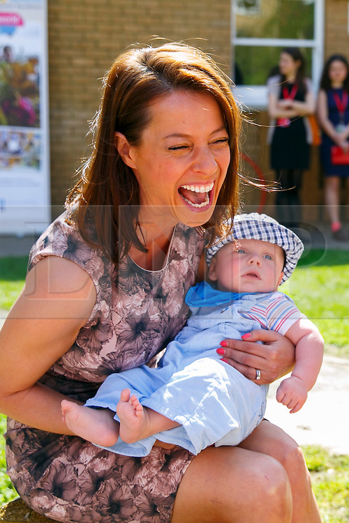 © Licensed to London News Pictures. 15/04/2015. LONDON, UK. Gloria De Piero, Labour Party's Shadow Minister for Women and Equalities holding Janosch, 5 month old, whilst meeting mothers and children at Stockwell Gardens Nursery in south London to launch Labour's Women's Manifesto on Wednesday, 15 April 2015. Photo credit : Tolga Akmen/LNP