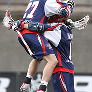 Kevin Buchanan #27 of the Boston Cannons jumps into the arms of Will Manny #1 of the Boston Cannons while celebrating a goal during the game at Harvard Stadium on April 27, 2014 in Boston, Massachusetts. (Photo by Elan Kawesch)