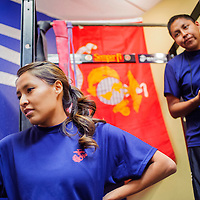 110414       Cable Hoover<br /> <br /> Tamaria Largo, left, and her brother time their fellow Marine Corps recruits during a workout at the recruiting office in the Rio West Mall Tuesday.