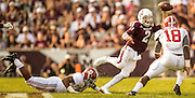 Sep 14, 2013; College Station, TX, USA; Texas A&M Aggies quarterback Johnny Manziel (2) scrambles against Alabama Crimson Tide linebacker Reggie Ragland (18) and linebacker Jonathan Allen (93) during the second half at Kyle Field. Mandatory Credit: Thomas Campbell-USA TODAY Sports