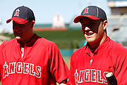 ANAHEIM, CA - JULY 28:  Mark Trumbo #44 (left) of the Los Angeles Angels of <br /> Anaheim and Mike Trout #27 of the Angels talk to fans before the game against the Tampa Bay Rays on Saturday, July 28, 2012 at Angel Stadium in Anaheim, California. The Rays won the game in a 3-0 shutout. (Photo by Paul Spinelli/MLB Photos via Getty Images) *** Local Caption *** Mark Trumbo;Mike Trout