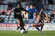 Rohan Ince is challenged Ian Henderson during the EFL Sky Bet League 1 match between Rochdale and Bury at Spotland, Rochdale, England on 26 August 2017. Photo by Daniel Youngs.