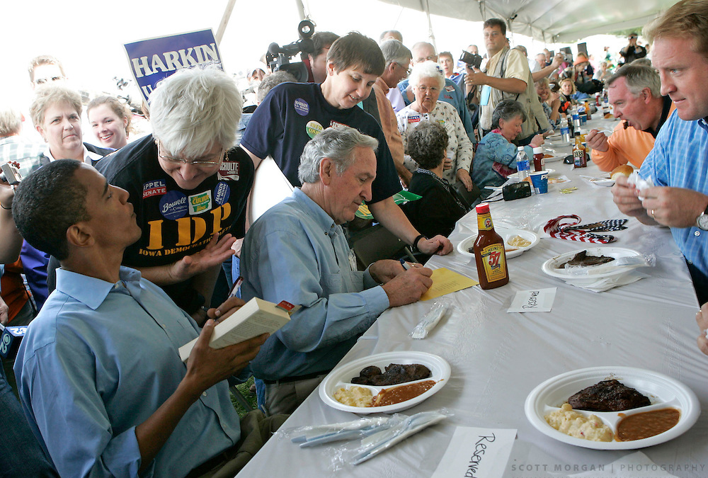 INDIANOLA, IA - SEPTEMBER 17: U.S. Sen. Barack Obama (D-IL), left, talks to supporters as he sits down to dinner with U.S. Sen. Tom Harkin (D-IA), center, and Iowa democratic governor candidate Chet Culver, rigth, Sunday Sept. 17, 2006 before speaking to local democrats during the Harkin Steak Fry at the Warren County Fairgrounds in Indianola, Iowa. (Photo by Scott Morgan/Getty Images)