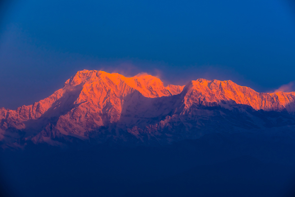 Sunrise on Annapurna South, Annapurna 1 (the 10th highest peak in the world) and Hiunchuli; three of the peaks of the Annapurna Massif (range) in the Himalayas, seen from Sarangkot,  near Pokhara, Nepal.