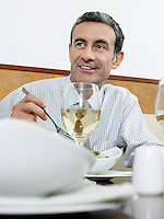 Businessman dining in restaurant
