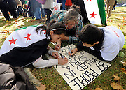 "35559258© Licensed to London News Pictures. 29/10/2011. London, UK.  Children help write a poster. Amnesty International join Syrians in the UK for a ""N0 More Blood - No More Fear"" march and rally in Paddington Green, London, today 29th October 2011. Activists claim  Syrian security forces opened fire on Friday on protesters and hunted them down in house-to-house raids, killing about 40 people in the deadliest day in weeks in the country's 7-month-old uprising. Photo: Stephen Simpson/LNP"