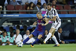 (L-R) Andres Iniesta of FC Barcelona, Andrea Barzagli of Juventus FC during the UEFA Champions League group D match between FC Barcelona and Juventus FC  on September 12, 2017  at the Camp Nou stadium in Barcelona, Spain.