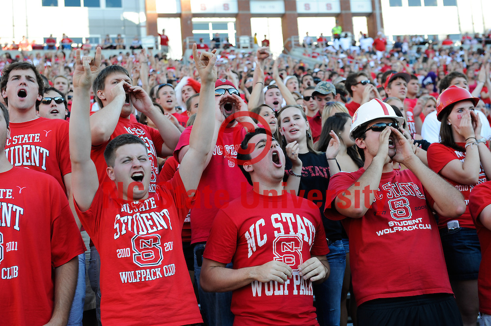 NC State fans cheer on the pack during a game against Western Carolina at Carter Finley stadium in Sept of 2010. Photo by Marc Hall