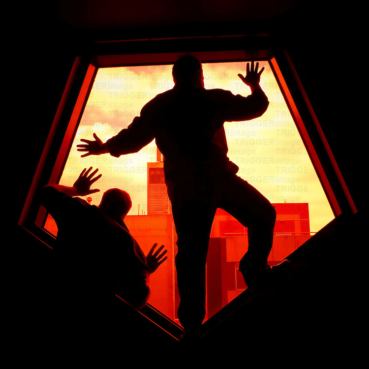 Two male silhouetted figures against a window in an urban environment
