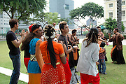 A cultural dance performance at a park in the city centre, Singapore