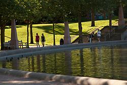 North America, United States, Washington, Bellevue, Bellevue Downtown Park, woman walking around fountain