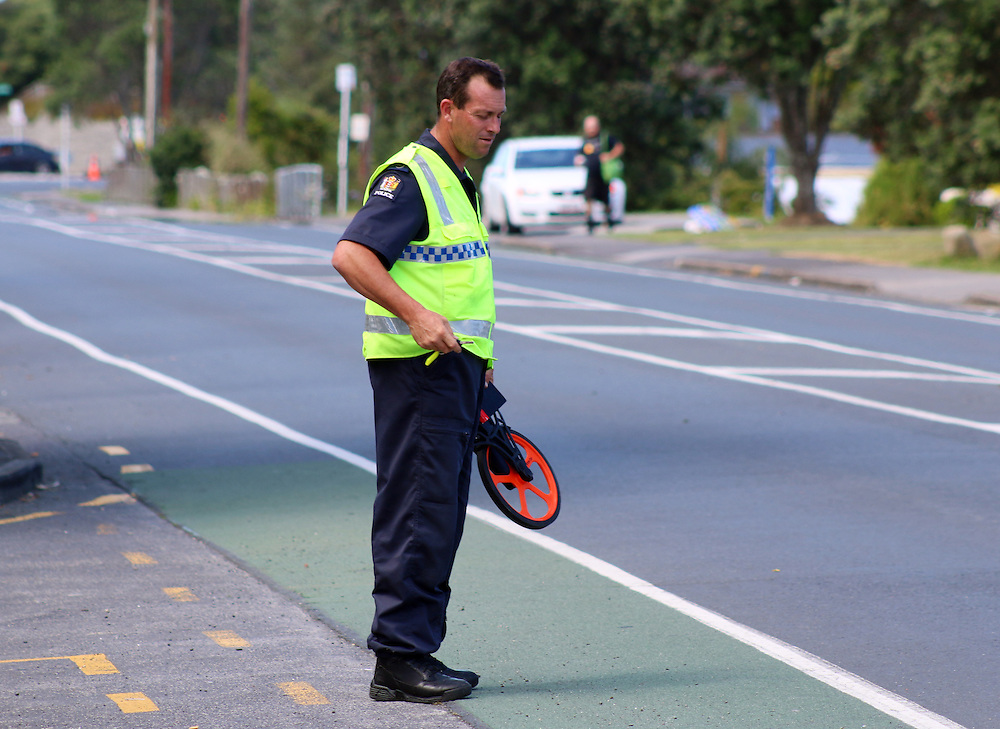 A car has hit a pedestrian and ended up on the verge on Don Buck Road, Massey, Auckland, New Zealand, Sunday, Januray 24, 2016. Credit:SNPA / Daniel Hines