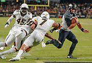 WEST LAFAYETTE, IN - SEPTEMBER 15: David Blough #11 of the Purdue Boilermakers runs for a touchdown as Cam Hilton #7 of the Missouri Tigers looks to make the stop at Ross-Ade Stadium on September 15, 2018 in West Lafayette, Indiana. (Photo by Michael Hickey/Getty Images) *** Local Caption *** David Blough; Cam Hilton NCAA Football - Purdue Boilermakers vs Missouri Tigers at Ross-Ade Stadium in West Lafayette, Indiana. Sports photographer by Michael Hickey