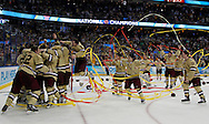Members of Boston College celebrate their victory over Ferris State in the NCAA Frozen Four college hockey tournament final game Saturday, April 7, 2012, in Tampa, Fla. Boston College won 4-1 to claim the National Championship. (AP Photo/Mike Carlson)