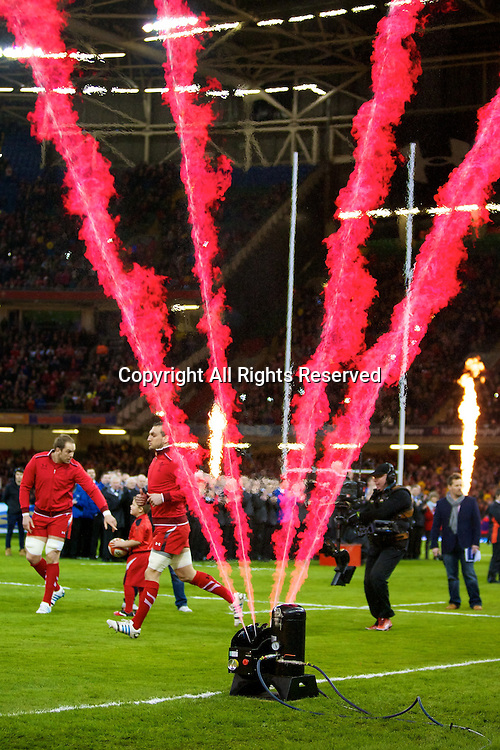 01.02.2014 Cardiff, Wales. The Wales team emerges to flames before the Six Nations game between Wales and Italy from the Millennium Stadium.