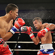 "Samuel Rodriguez (right) fights Jayron Santiago during a ""Boxeo Telemundo""  boxing match at the Kissimmee Civic Center on Friday, July 18, 2014 in Kissimmee, Florida. Rodriguez won the bout. (AP Photo/Alex Menendez)"