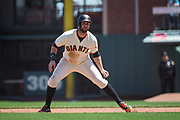 San Francisco Giants left fielder Brandon Belt (9) plays with the Los Angeles Dodgers pitcher at first base at AT&T Park in San Francisco, California, on April 27, 2017. (Stan Olszewski/Special to S.F. Examiner)