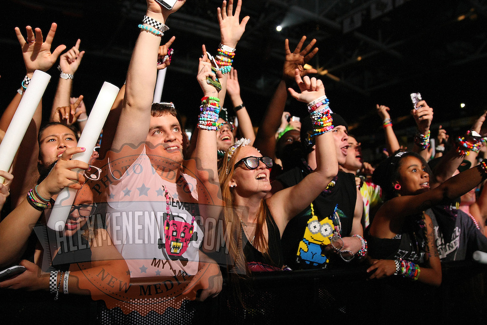 Fans line the front row during the performance by the band Krewella, during the Verge Campus Spring Tour concert at the CFE Arena on the University of Central Florida campus, Tuesday, April 8, 2014, in Orlando, Florida.  (AP Photo/Alex Menendez)