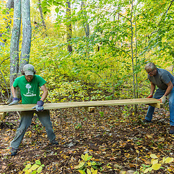 Two men work on a hiking trail in Marshfield, Massachusetts. Hoyt-Hall Preserve.