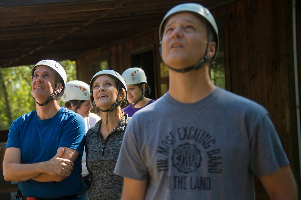 (From left) Dean Gaboury, Pamela Gaboury and Steve Mace watch people zipline at The Ridges on Parents Weekend. Photo by Hannah Ruhoff