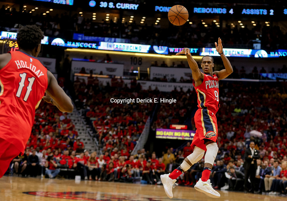 May 4, 2018; New Orleans, LA, USA; New Orleans Pelicans guard Rajon Rondo (9) passes the ball to guard Jrue Holiday (11) during the third quarter in game three of the second round of the 2018 NBA Playoffs against the Golden State Warriors at Smoothie King Center. The Pelicans defeated the Warriors 119-100.  Mandatory Credit: Derick E. Hingle-USA TODAY Sports