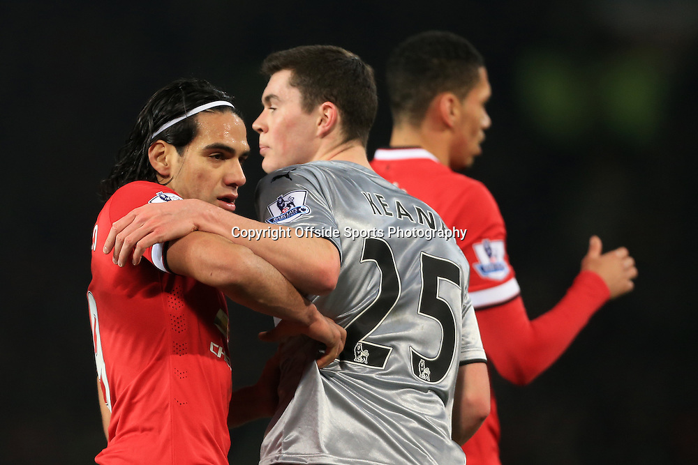 11th February 2015 - Barclays Premier League - Manchester United v Burnley - Radamel Falcao of Man Utd tussles with Michael Keane of Burnley - Photo: Simon Stacpoole / Offside.