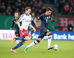 Football: Germany, DFB Cup<br /> Marcell Jansen (Hamburger SV, HSV) - <br /> Mario Mandzukic (FC Bayern Muenchen)