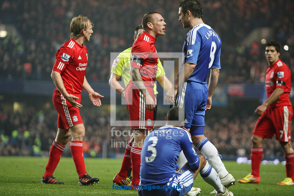 Picture by Paul Terry/Focus Images Ltd. 07545642257.20/11/11.Frank Lampard of Chelsea and Craig Bellamy of Liverpool come face to face during the Barclays Premier League match at Stamford Bridge stadium, London.