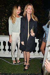 Left to right, KIMI HAMMERSTROEM and LUCY GREENE at a private view of photographs by Marc Lagrange at Heist, 43 Linden Gardens, London on 2nd October 2014.