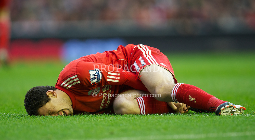 LIVERPOOL, ENGLAND - Saturday, December 10, 2011: Liverpool's Maximiliano Ruben Maxi Rodriguez lies down injured during the Premiership match against Queens Park Rangers at Anfield. (Pic by David Rawcliffe/Propaganda)
