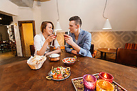 Young couple having wine at restaurant table