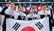 Ahn Se Jung & Noh Do Hee & Kim Alang & Kong Sangjeong with gold medals while Korean flag during medal ceremony of the Relay Women's 3000 Meters on day three of the 2013 ISU Short Track Speed Skating Junior World Championships at Torwar Ice Hall on February 24, 2013 in Warsaw, Poland...Poland, Warsaw, February 24, 2013...Picture also available in RAW (NEF) or TIFF format on special request...For editorial use only. Any commercial or promotional use requires permission...Photo by © Adam Nurkiewicz / Mediasport