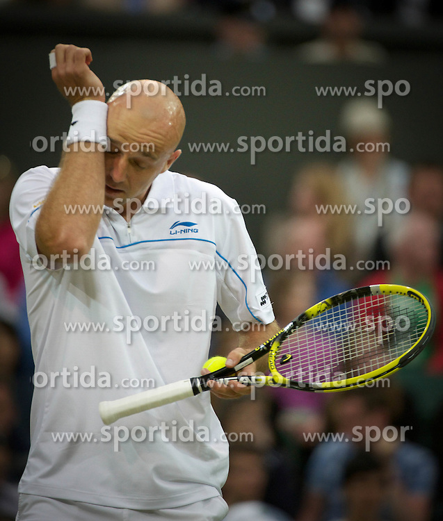 24.06.2011, Wimbledon, London, GBR, Wimbledon Tennis Championships, im Bild Ivan Ljubicic (CRO) in action during the Gentlemen's Singles 3rd Round match on day five of the Wimbledon Lawn Tennis Championships at the All England Lawn Tennis and Croquet Club, EXPA Pictures © 2011, PhotoCredit: EXPA/ Propaganda/ *** ATTENTION *** UK OUT!