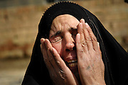 A local Iraqi woman cries after her husband is detained during Operation Brown Hawk in Tahrir, Iraq, on Feb. 27, 2007. The purpose of Operation Brown Hawk is to eliminate Tahrir as an operating base for improvised explosive device building cells and key leaders of the Al-Qaeda forces in Iraq.