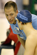 Eastridge High School coach Jason Weber speaks to Nick Evershed before Evershed's 100-yard breaststroke race at the Section V Class B Swimming Championships at Webster Aquatic Center on Friday, February 14, 2014. Evershed finished third in a time of 1:04.92.