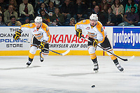 KELOWNA, CANADA - OCTOBER 25: Ivan Provorov #9 and Ryan Pilon #6 of Brandon Wheat Kings skate against the Kelowna Rockets on October 25, 2014 at Prospera Place in Kelowna, British Columbia, Canada.  (Photo by Marissa Baecker/Shoot the Breeze)  *** Local Caption *** Ivan Provorov; Ryan Pilon;