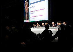 Jan-Michiel Hessels, vice chairman of Fortis, is seen on a giant video screen during an extraordinary shareholders meeting in Brussels, Belgium, on Friday, Dec. 19, 2008. Fortis, the insurer that was once Belgium?s largest financial-services firm, clashed with some investors at a meeting in Brussels by sticking to an agreement to sell the Belgian insurance business to BNP Paribas SA. (Photo © Jock Fistick)