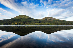 © Licensed to London News Pictures. 16/09/2015. Buttermere, UK. Picture shows the mountains reflecting in the water of Buttermere, Cumbria woke this morning to Bright sunshine. Photo credit: Andrew McCaren/LNP