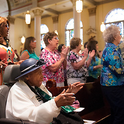 2 AUG. 2015 -- ST. LOUIS -- Oralynn Allen (front) joins other worshipers during Mass Mob III at Sts. Teresa and Bridget Catholic Parish in St. Louis Sunday, Aug. 2, 2015. The event brings Catholics from across the Archdiocese of St. Louis to worship at historic, urban parishes.<br /> <br /> Photo by Sid Hastings.