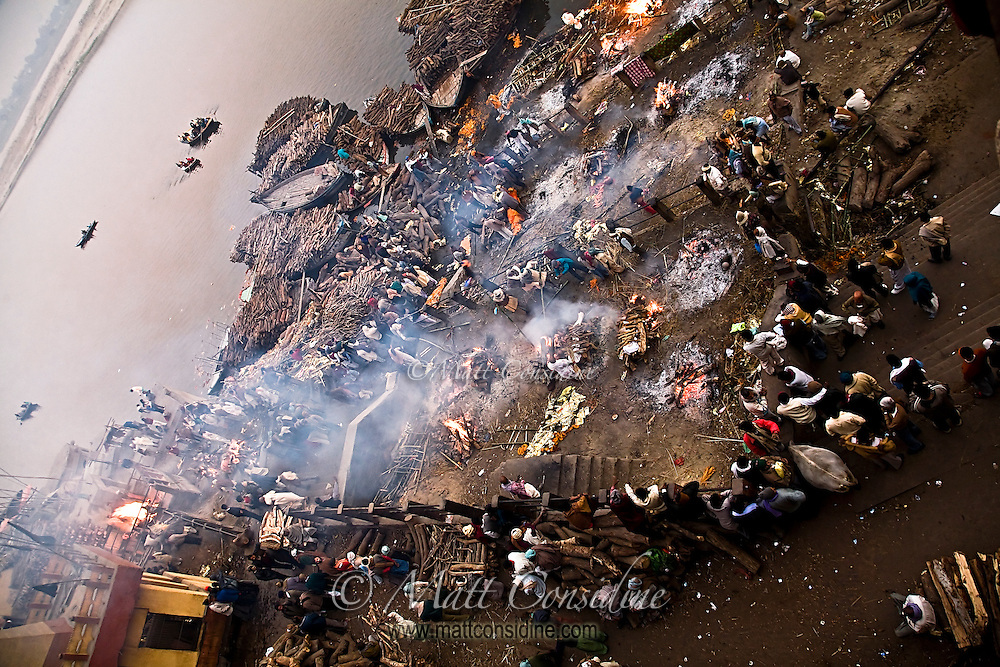 A single shot taken from the smoke blackened balcony above the burning ghat where hundred of bodies are cremated every day.<br /> (Photo by Matt Considine - Images of Asia Collection)
