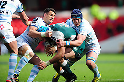 Graham Kitchener of Leicester Tigers is tackled by Dan Carter of Racing 92 - Mandatory byline: Patrick Khachfe/JMP - 07966 386802 - 24/04/2016 - RUGBY UNION - The City Ground - Nottingham, England - Leicester Tigers v Racing 92 - European Rugby Champions Cup Semi Final.